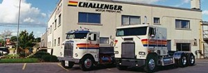 Old Challenger building and trucks